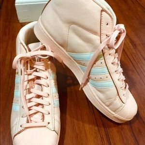 Ladies peach colored adidas. Worn once. Pro model